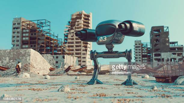 futuristic mech warrior with weapons stands in the middle of demolished city - film stock pictures, royalty-free photos & images