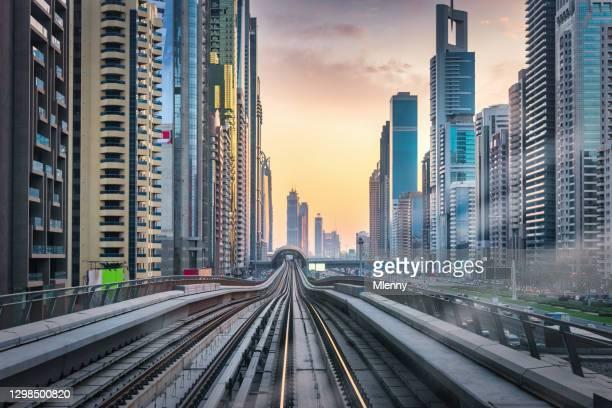 futuristic mega city dubai at sunrise united arab emirates - mlenny stock pictures, royalty-free photos & images