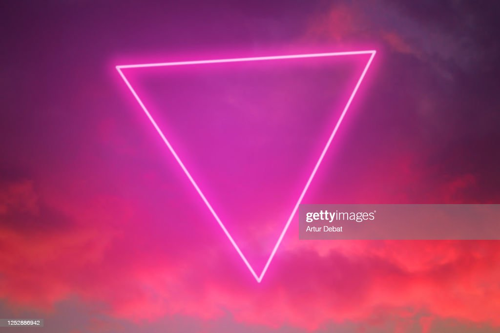 Futuristic neon triangle in the burning sky with stunning pink colors. : Stock Photo