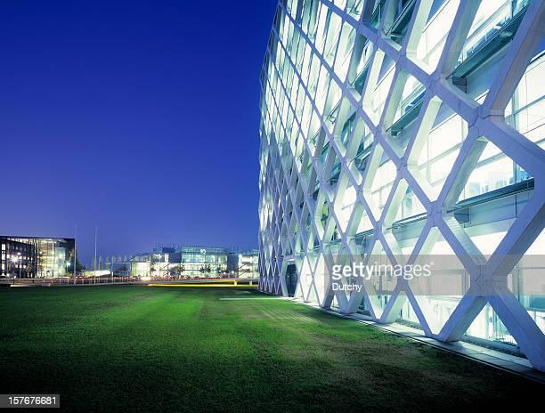 futuristic office park at night. - prosperity stockfoto's en -beelden