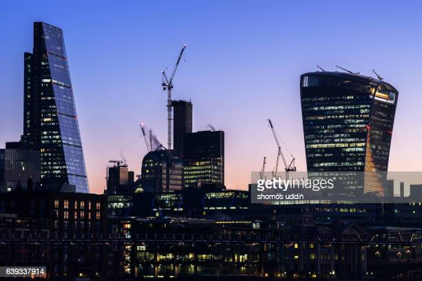 Futuristic office towers lit up at twilight