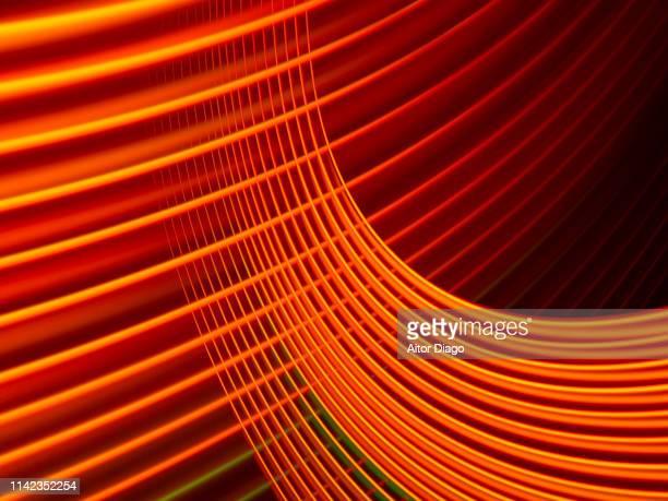 futuristic orange curved lines interlaced. virtual environment. 3d. - orange couleur photos et images de collection