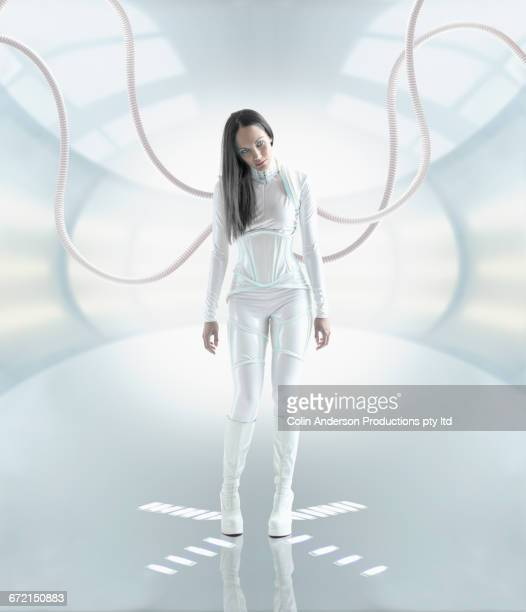Futuristic Pacific Islander woman android recharging from hoses