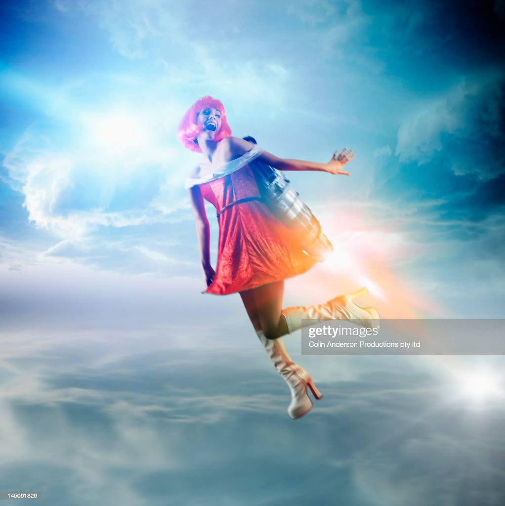 Futuristic Pacific Islander woman flying with jetpack : Stock Photo