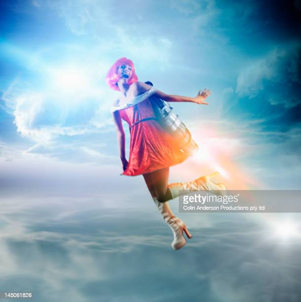 Futuristic Pacific Islander woman flying with jetpack