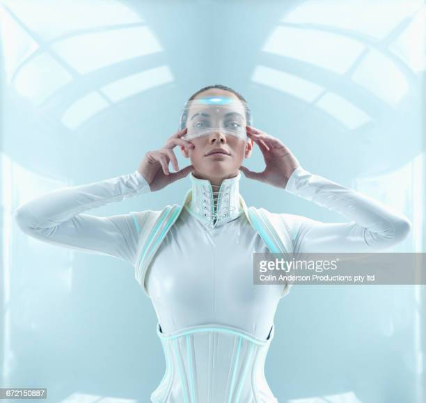 Futuristic Pacific Islander woman holding display screen to face