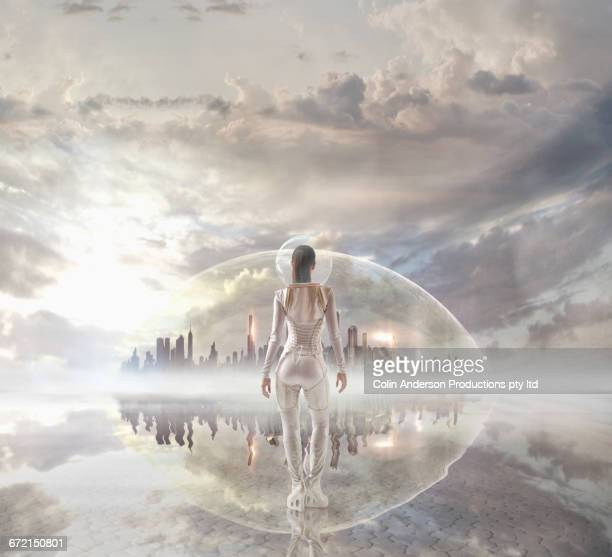 Futuristic Pacific Islander woman looking at distant city under dome