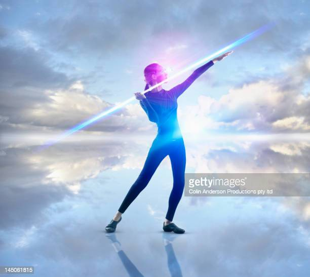 Futuristic Pacific Islander woman throwing bolt of light