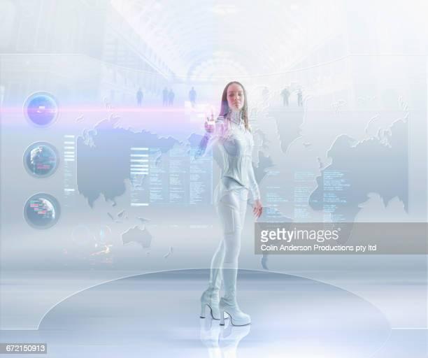 Futuristic Pacific Islander woman touching hologram map