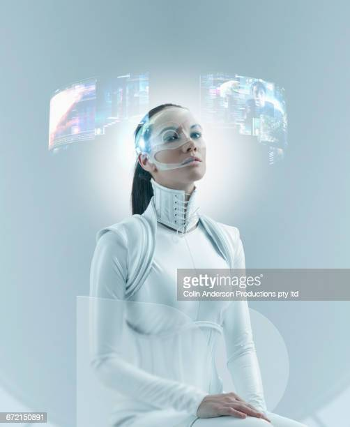 Futuristic Pacific Islander woman watching holograms