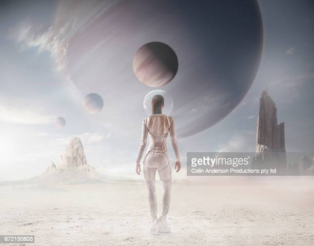 Futuristic Pacific Islander woman watching planets in sky