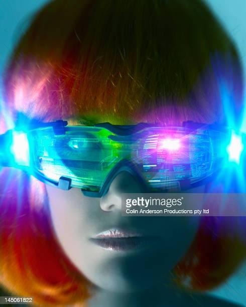 Futuristic Pacific Islander woman wearing digital eyeglasses