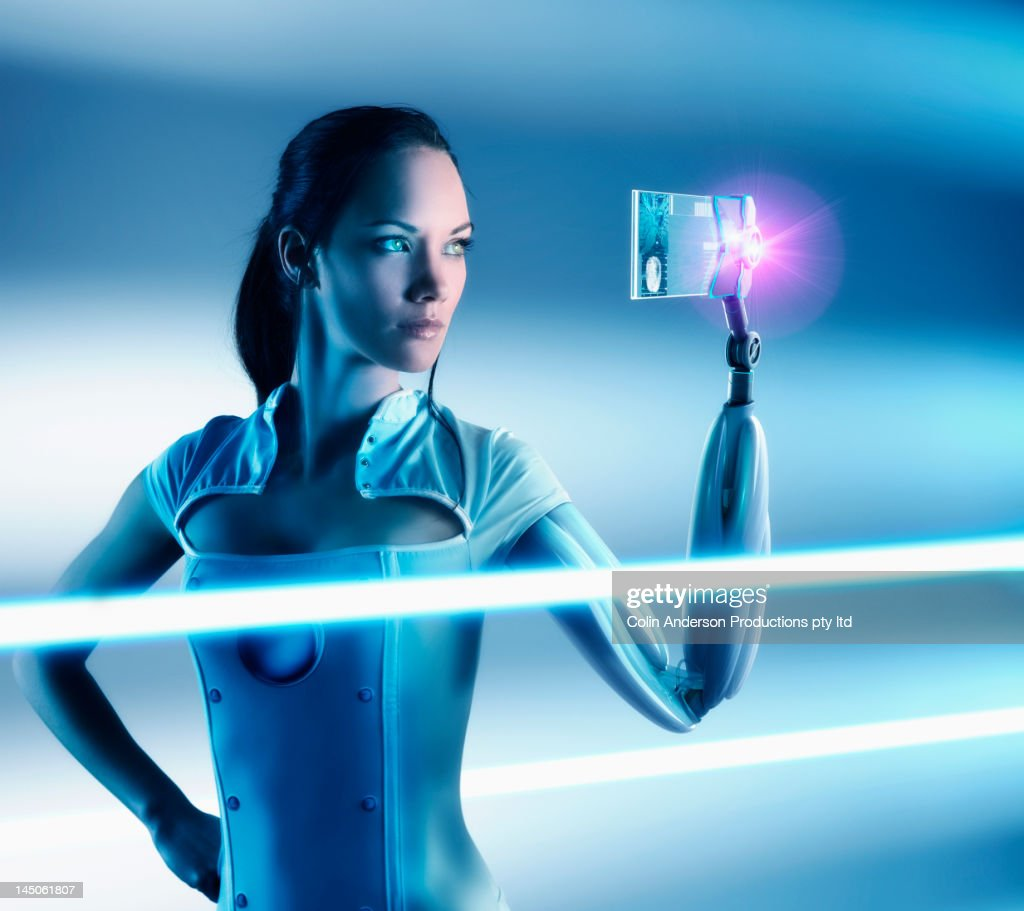 Futuristic Pacific Islander woman with robotic arm : Stock Photo
