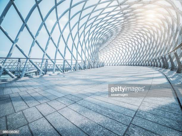 futuristic pedestrian footbridge against sky - the way forward stock pictures, royalty-free photos & images