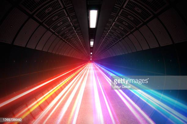 futuristic picture of colorful light trails moving fast in subway tunnel. - connection stock pictures, royalty-free photos & images