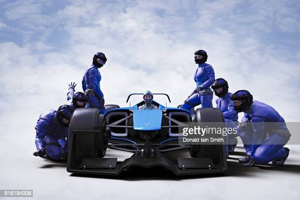 Futuristic pit crew servicing race car