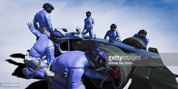 Futuristic pit crew servicing race car