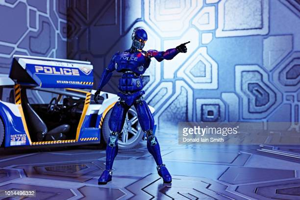 Futuristic police robot standing beside police car searching and pointing