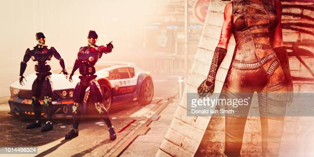 Futuristic police robots standing beside police car searching and pointing towards woman hiding