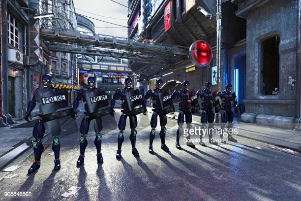 Futuristic police standing in street with shields