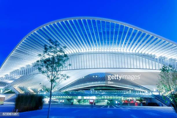 futuristic railway station building illuminated at night - station stock pictures, royalty-free photos & images