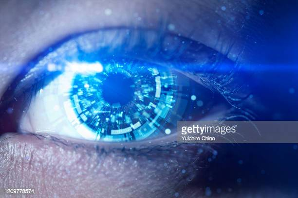 a futuristic robotic eye - robot stock pictures, royalty-free photos & images