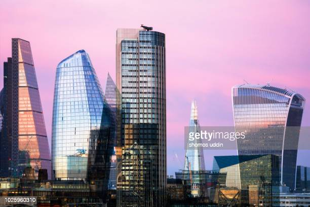 Futuristic skyline of London city at twilight - multiple exposure
