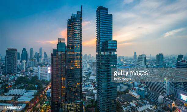 futuristic skyscraper cityscape at sunset bangkok highrise tower panorama thailand - indochina stock pictures, royalty-free photos & images