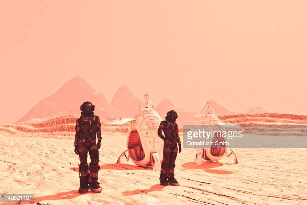 futuristic space travelers near spaceships - mars stock pictures, royalty-free photos & images