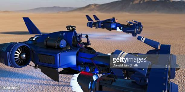 Futuristic vehicles flying in desert