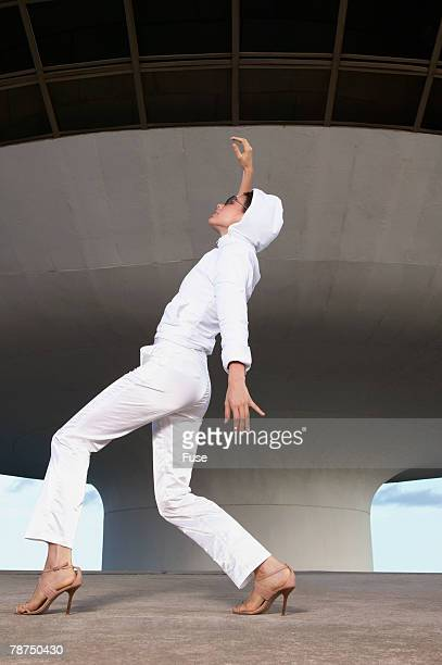 Futuristic Woman Dancing in Front of Modern Building