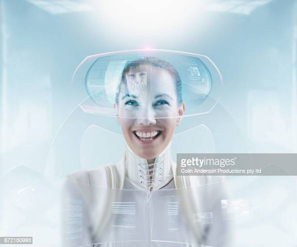 Futuristic woman video conferencing with daughter on hologram screen