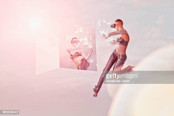 Futuristic woman wearing virtual reality goggles near hologram mirror