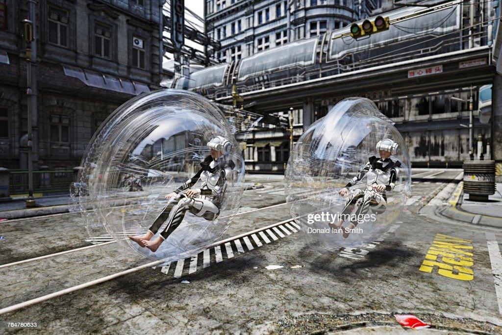 Futuristic women riding in transparent transportation : Stock Photo