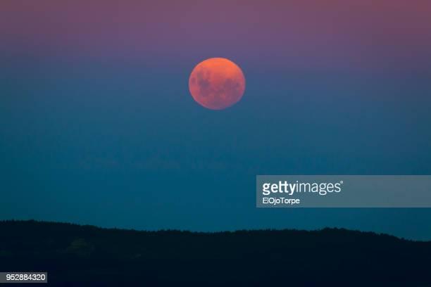 Fuul moon rising over a hill, Rocha department, Uruguay
