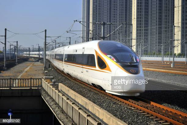 A 'Fuxing' bullet train arrives at Jinan West Railway Station on September 21 2017 in Jinan Shandong Province of China China's 'Fuxing' bullet trains...