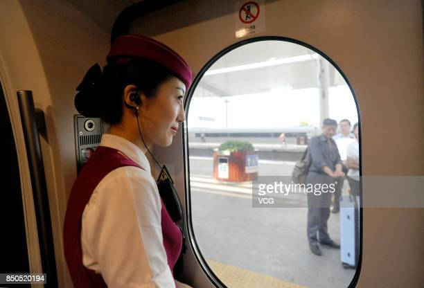 A 'Fuxing' bullet train arrives at Jining West Railway Station on September 21 2017 in Jining Shandong Province of China China's 'Fuxing' bullet...