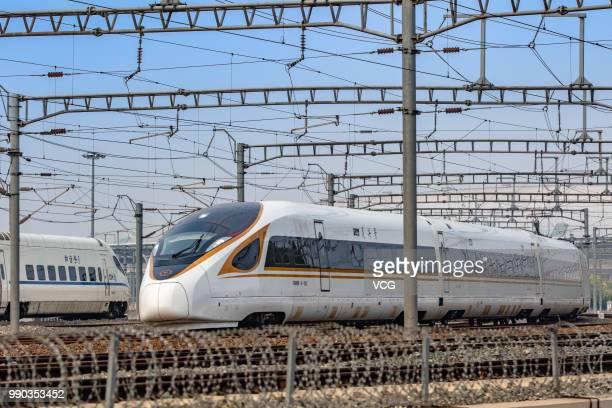 Fuxing bullet train runs on the BeijingâShanghai High-Speed Railway on July 1, 2018 in Beijing, China. New longer Fuxing bullet trains start...