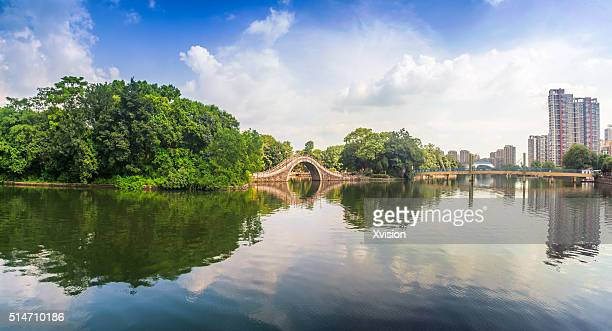 Fuzhou City People's Park with the West Lake in summer under blue sky