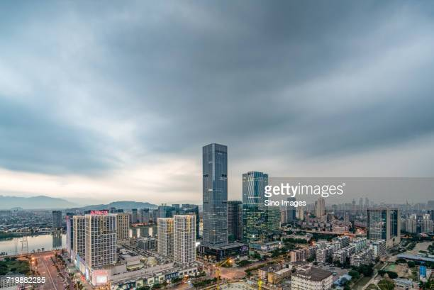 Fuzhou skyline with modern skyscrapers against moody sky / Fuzhou, Fujian, China
