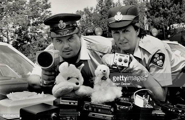 Fuzzbuster busters Ontario Provincial Police Constables Cam Woolley and Laura Hicks show off some of the electronic equipment used by and against...