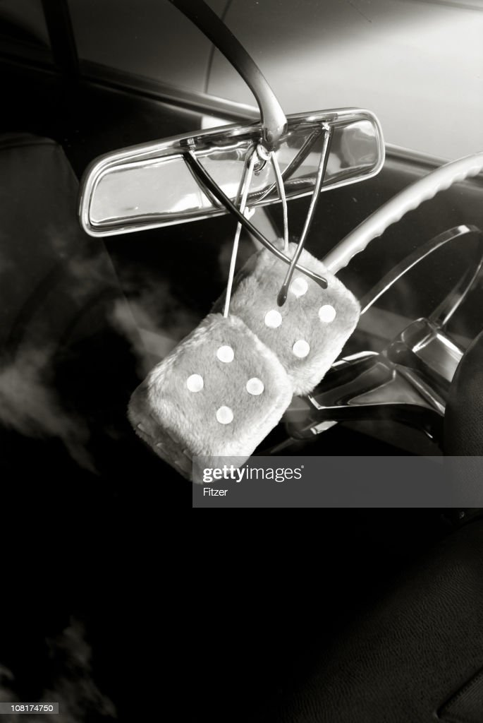 fuzzy dice in rearview mirror black and white stock photo getty images. Black Bedroom Furniture Sets. Home Design Ideas