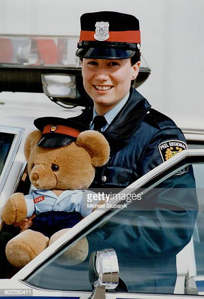 Fuzzy new recruit joins Peel police Peel Regional Police Constable Cheryl Wilson holds one of nearly 200 teddy bears wearing custommade police...