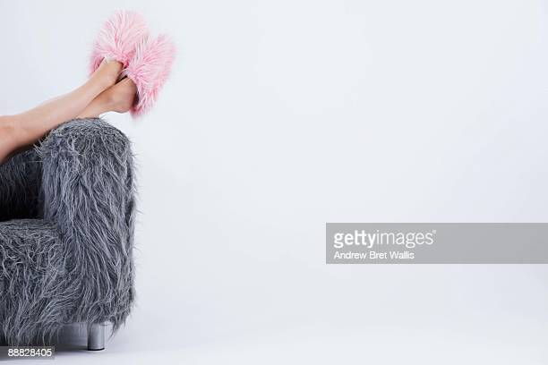 fuzzy slippers and sofa - hairy women stock pictures, royalty-free photos & images