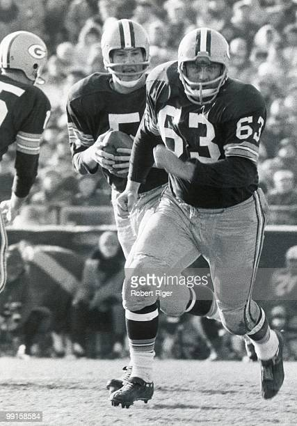 Fuzzy Thurston of the Green Bay Packers blocks for Paul Hornung during a circa 1960s game at City Field in Green Bay Wisconsin