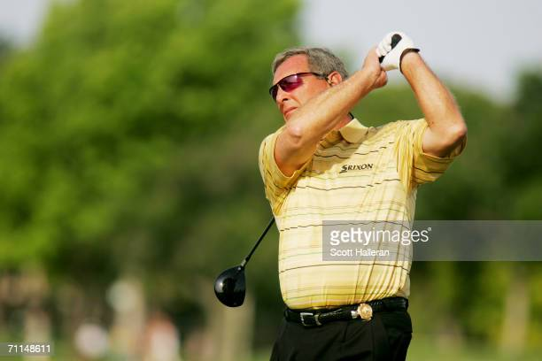 Fuzzy Zoeller hits a shot during the second round of the 67th Senior PGA Championship at the Oak Tree Golf Club on May 26 2006 in Edmond Oklahoma