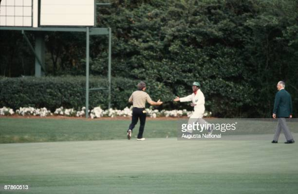 Fuzzy Zoeller is congratulated by his caddie during the 1979 Masters Tournament at Augusta National Golf Club on April 1979 in Augusta Georgia