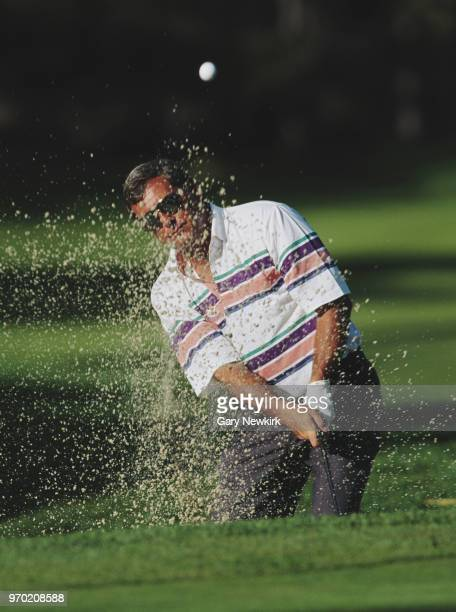 Fuzzy Zoeller of the United States plays out of a bunker during the ATT Pebble Beach ProAm golf tournament on 5 February 1995 at the Pebble Beach...