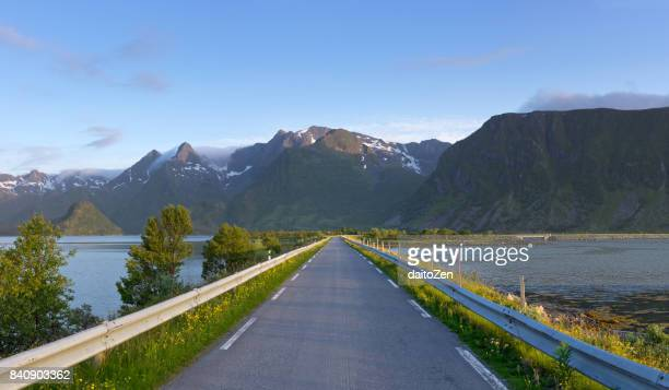 Fv888 country road near Grunnførfjord on Austvagoy Island with impressive mountain range, Lofoten archipelago, Nordland, Norway
