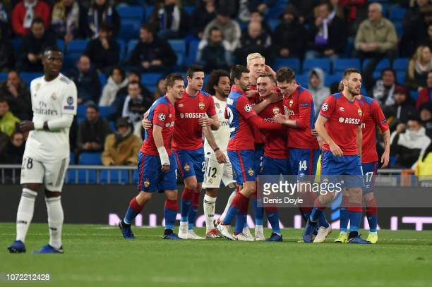 Fyodor Chalov of CSK Moscow celebrates with teammates after scoring his team's first goal during the UEFA Champions League Group G match between Real...